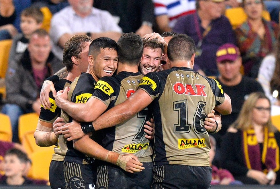 BRISBANE, AUSTRALIA - JULY 22:  Zak Hardaker of the Panthers is congratulated by team mates after scoring a try during the round 20 NRL match between the Brisbane Broncos and the Penrith Panthers at Suncorp Stadium on July 22, 2016 in Brisbane, Australia.  (Photo by Bradley Kanaris/Getty Images)