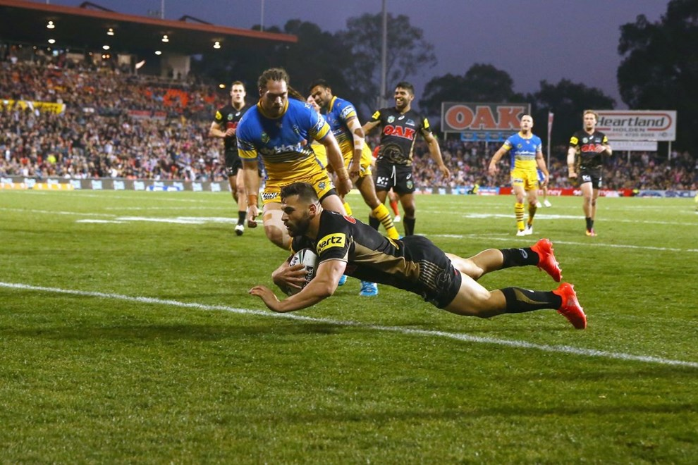 SYDNEY, AUSTRALIA - JULY 17:  Josh Mansour of the Panthers scores a try during the round 19 NRL match between the Penrith Panthers and the Parramatta Eels at Pepper Stadium on July 17, 2016 in Sydney, Australia.  (Photo by Mark Kolbe/Getty Images)