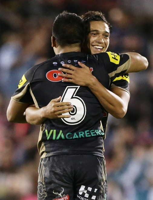 SYDNEY, AUSTRALIA - MARCH 19:  Te Maire Martin of the Panthers celebrates victory with team mate Tyrone Peachey during the round three NRL match between the Penrith Panthers and the Brisbane Broncos at Pepper Stadium on March 19, 2016 in Sydney, Australia.  (Photo by Mark Metcalfe/Getty Images)