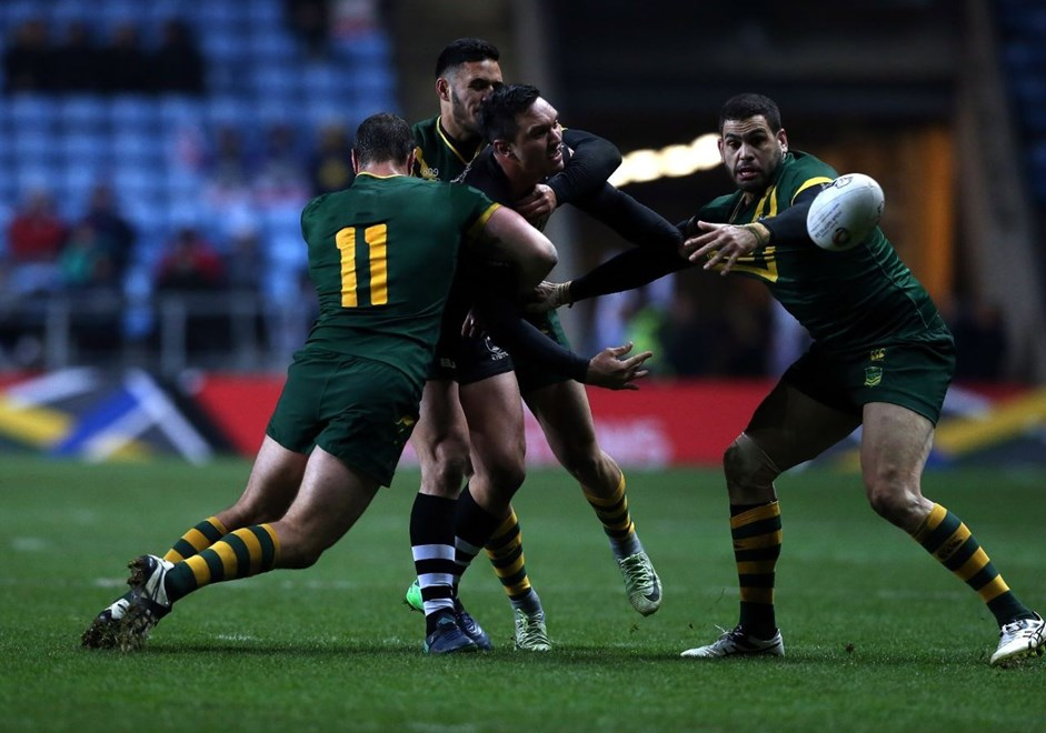 COVENTRY, ENGLAND - NOVEMBER 05:  Jordan Rapana (2ndR) of New Zealand Kiwis tackled by Boyd Cordner (L), Valentine Holmes (2ndL) and Greg Inglis (R) of Australia Kangaroos during the Four Nations match between the New Zealand Kiwis and Australian Kangaroos at The Ricoh Arena on November 5, 2016 in Coventry, United Kingdom.  (Photo by Nigel Roddis/Getty Images)